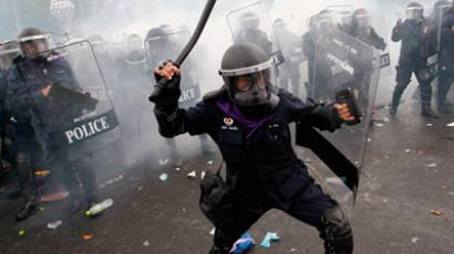 Tear gas is thrown as police scuffle with anti-government protesters in Bangkok November 24, 2012.(Reuters / Sukree Sukplang)
