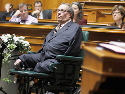 Swiss National Councillor Christian Lohr speaks during a debate in the National Council during the spring parliament session in Bern, March 8, 2012. Lohr was born with disabilities due to a drug based on thalidomide. (Reuters/Michael Buholzer)