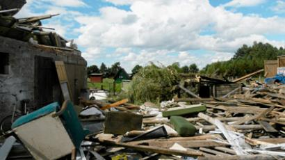 Pieces of wood and bricks surround a destroyed house following a tornado in the village of Osia July 15, 2012 (Reuters / Agencja Gazeta)