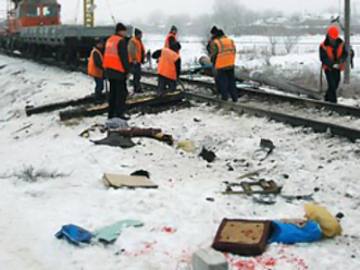 Train slams into bus in Russia killing six