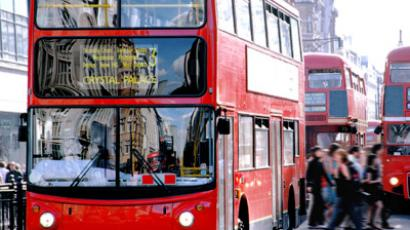 Iconic London bus heads through the city center.