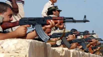 Libyan youths practice using rifles during training to join the fighting forces of the National Transitional Council (NTC) in the town of Tajura, Tripoli, on September 14, 2011. (AFP Photo / Mahmud Turkia)