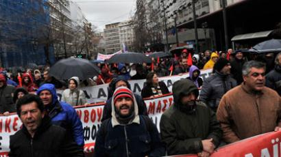 Striking Greek steel workers march towards the Greek Parliament during a 24-hour general strike in Athens on February 7, 2012.(AFP Photo / Louisa Gouliamaki)