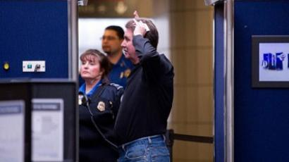 A male traveler submits to a full body scan before heading to his flight at Pittsburgh International Airport. (Jeff Swensen / Getty Images / AFP)