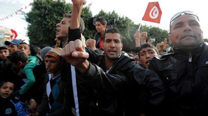 Inhabitants of Sidi Bouzid shout slogans before hurling rocks at Tunisia's President Moncef Marzouki and parliamentary speaker Mustapha Ben Jaafar on December 17, 2012, in the central town of Sidi Bouzid. (AFP Photo / Fethi Belaid)
