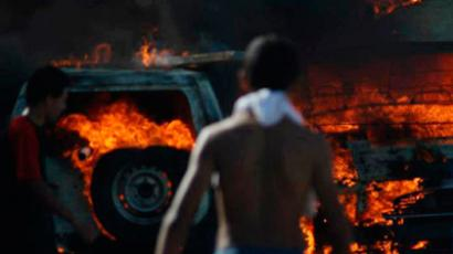 Police cars burn after they were set ablaze by protesters demonstrating against the reopening of a rubbish dump on Guellala in island of Djerba October 6, 2012 (Reuters / Stringer)