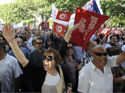 Tunisian demonstrators shout slogans in the Habib Bourguiba Avenue in Tunis on October 22, 2012 as more than 1,000 opposition activists staged a protest against the Islamist-led government and political violence, days after the death of an opposition party official. (AFP Photo/Fethi Belaid)