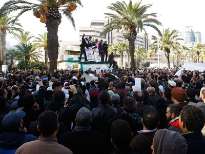 Pro-government Islamists shout slogans during a demonstration against the UGTT labour union, which has called for a general strike demanding the removal of the government led by the Islamist Ennahda party, in Tunis December 8, 2012.(Reuters / Zoubeir Souissi)