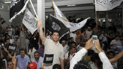 Tunisian Islamist party Hizb Ettahrir's supporters shout slogans and wave flags during a congress organised by the banned Islamist party advocating the restoration of the caliphate, on June 24, 2012 in Tunis (AFP Photo/Fethi Belaid)