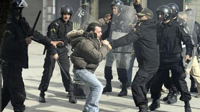 Police officers beat a demonstrator in the center of Tunis on January 17, 2011 (AFP Photo / Fred Dufour)