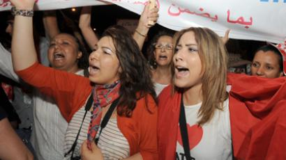 Tunisian women shout slogans during a protest calling for the respect of women's rights and other fundemental rights on August 13, 2012 in Tunis (AFP Photo / Fethi Belaid)