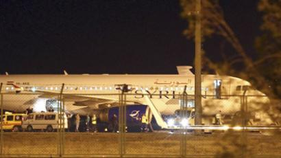A Syrian passenger plane which was forced to land sits at Esenboga airport in Ankara October 10, 2012.  (Reuters/Cem Oksuz/Anadolu Agency)