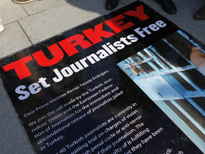 Journalists and their supporters gather outside the Justice Palace to protest against the detention of journalists in Istanbul December 26, 2011. (Reuters/Murad Sezer)