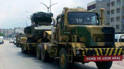 "Turkish military trucks carry missile batteries on June 28, 2012 in the center of Hatay. Turkey is sending missile batteries and army vehicles to the border with Syria as a ""security corridor"", almost a week after the Syrian downing of a Turkish military jet, media reports said. There was no official confirmation of the reported military moves. (AFP Photo/Ihlas News Agence)"