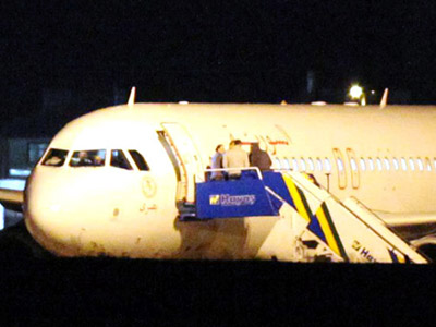 A Syrian passenger plane is seen after it was forced to land at Ankara airport on October 10, 2012.  (AFP Photo/Adem Altan)