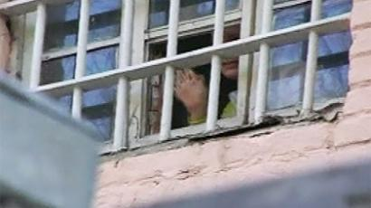 Fans could see their beloved 'Yulia' waving to them from behind bars