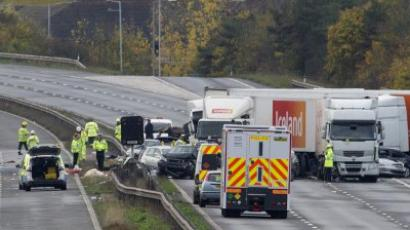Taunton: Rescuers and police stand at the scene of massive crash on the M5 motorway near Taunton in Somerset, south-west England, on November 5, 2011. (AFP Photo/Carl Court)