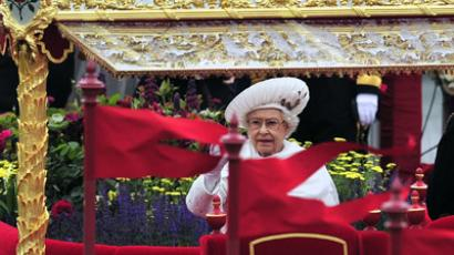 Britain's Queen Elizabeth II waves as she travels aboard the Royal Barge 'Spirit of Chartwell' in the Diamond Jubilee Pageant on the River Thames in London, on June 3, 2012. (AFP Photo/Glyn Kirk)