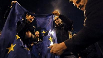 Demonstrators burn an EU flag near the EU offices in Athens to protest against austerity measures announced by the Greek government (AFP Photo / Louisa Gouliamaki)
