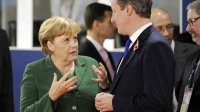German Chancellor Angela Merkel (L) talks with British Prime Minister David Cameron (AFP Photo / ERIC FEFERBERG)