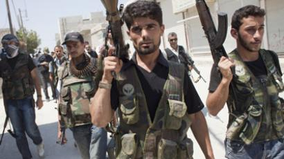 Syrian opposition fighters take part in battles against Syrian government forces in the Karm al-Tarab neighborhood of Aleppo on August 17, 2012. (AFP Photo/Achilleas Zavallis)