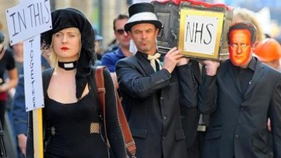 Protesters hold a mock funeral for the NHS in Bristol, UK.Photo from www.thisisbristol.co.uk