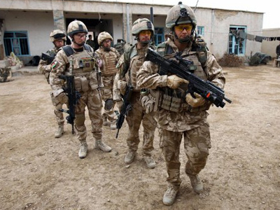UK troops may stay in Afghanistan beyond 2014 - official