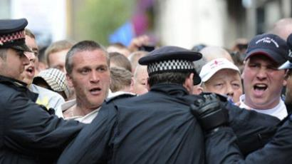 Members of the right-wing EDL (English Defence League) scuffle with police as they take part in a protest in Tower Hamlets, east London (AFP Photo / CARL COURT)