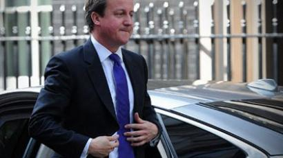 British Prime Minister David Cameron returns to Downing Street in central London on April 30, 2012 (AFP Photo / Carl Court)