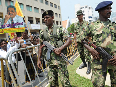 Sri Lankan soldiers keep watch during a protest in Colombo on February 27, 2012. (AFP Photo / Ishara S. Kodikara)