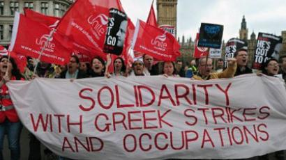 Striking public sector workers march in protest through central London, on May 10, 2012. (AFP Photo / Carl Court)