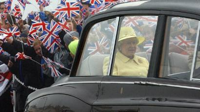 The crowd waves their Union Jack flags as The Queen leaves Seaham, Sunderland (AFP Photo / John Giles)