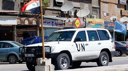 U.N. vehicle transports senior U.N. members of the United Nations observers mission in Syria (UNSMIS) during a field visit to the town of Harsta, near Damascus, June 12, 2012 (Reuters/SANA/Handout)