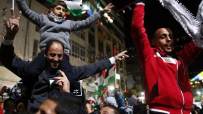Palestinians shout slogans during a rally in the West Bank city of Ramallah November 29, 2012. (Reuters/Marko Djurica)