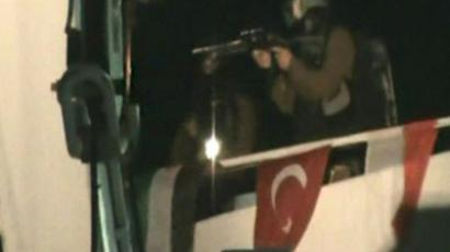 "A television grab made from the Turkish TV channel Cihan News Agency shows an Israeli commando member storming the ""Mavi Marmara"" Turkish aid boat, carrying aid to the Gaza Strip, on May 30, 2010 (AFP Photo / CIHAN NEWS AGENCY)"
