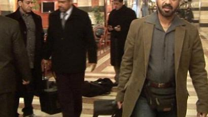 Damascus: A still image taken from an AFP video shows unidentified members of the Arab League mission leaving their Damascus hotel with suitcases on January 25, 2012. (AFP PHOTO)