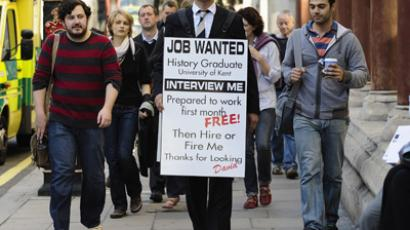 Jobless Rowe wears a sandwich board advertising his search for employment as he walks along Fleet Street in central London. (Reuters / Kieran Doherty)