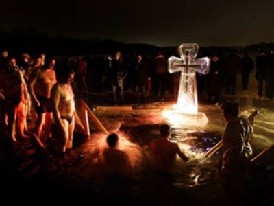 Unexpected baptism: 70 get an ice-cold dip during Orthodox celebrations