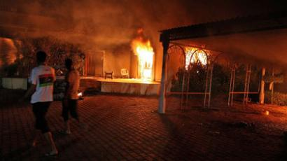 A vehicle (R) and the surround buildings burn after they were set on fire inside the US consulate compound in Benghazi late on September 11, 2012.(AFP Photo / STR) Video from doualia.com