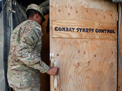 A US Army soldier enters the Combat Stress Control Clinic of 125 BSB Charlie Medical Company of Task Force Mustang at Forward Operating Base (FOB) Shank in Logar province, eastern Afghanistan (Reuters/Umit Bektas)