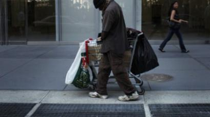 A homeless man walks down the street in New York City (Spencer Platt / Getty Images / AFP Photo)