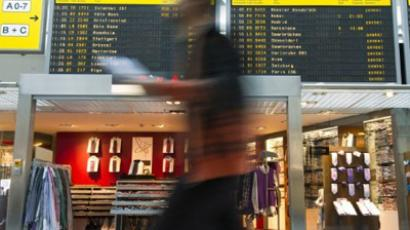 Berlin : A passenger walks past an electronic billboard that shows cancelled flights in the main hall of Berlin's Tegel airport on May 25, 2011. (AFP Photo / John Macdougall)