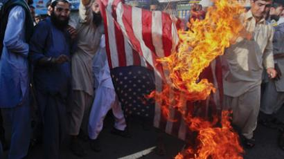 Supporters of the religious party Ahle Sunnat wal Jamaat burn a U.S. flag during a protest rally against an anti-Islam film made in the U.S. they say mocks the Prophet Mohammad, in Karachi, Pakistan September 30, 2012 (Reuters/Akhtar Soomro)