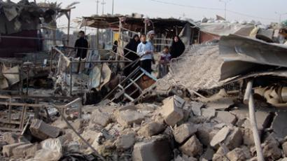 The site of a bomb attack that struck a market in Shula district, northwestern Baghdad, December 22, 2011 (Reuters / Stringer)
