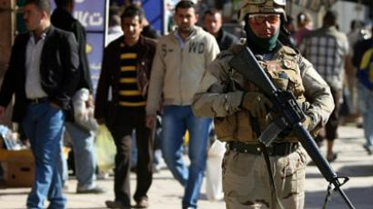 An US soldier secures a street in Baghdad on December 9, 2011 (AFP Photo / AHMAD AL-RUBAYE)