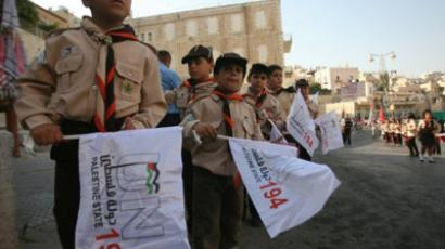 "Palestinian scout teams celebrate the centenary of the founding of the Bethlehem Boy Scouts under the slogan: ""Yes to the State of Palestine.. UN resolution 194"" in the biblical West Bank town on September 18, 2011 (AFP Photo / MUSA AL-SHAER)"