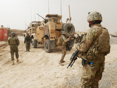U.S. soldiers keep watch at the entrance of a U.S. base in Panjwai district Kandahar province, March 11, 2012 (Reuters / Ahmad Nadeem)