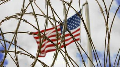 Guantanamo Bay: The US flag flies above the Camp Delta Maximun Security area. (AFP Photo / Paul J. Richards)