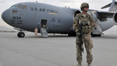 Army Sgt. 1st Class Jon Waterhouse, deployed from the 127th Military Police Company, Fort Carson, Colo., provides security near a C-17 Globemaster on the military side of Kabul International Airport, in Kabul, Afghanistan, Oct. 20, 2011. ((U.S. Air Force photo/Master Sgt. Michael O'Connor/Released))