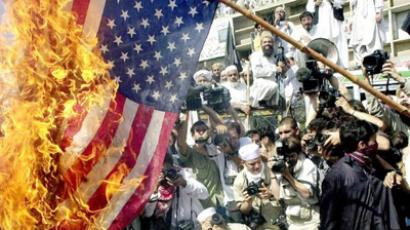 Pakistani radical Mulsims burn the American flag during a demonstration near a local mosque in down town Peshawar after performing Friday noon prayers protesting against the US-led air strikes on Afghanistan 12 October 2001 (AFP Photo / Tariq Mahmood)